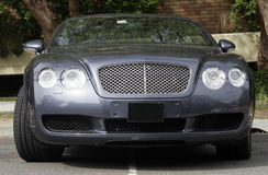 Car Front. Front Of A Blue Metallic Large Car On A Street Royalty Free Stock Image