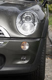 Car Front. Front Of A Grey Metallic Small Car On A Street Stock Image
