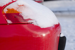 Car front lamp covered with snow in winter weather Stock Photos