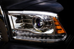 Car front light in closeup Royalty Free Stock Photo