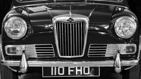 Car in Front View Showing Grille Royalty Free Stock Image