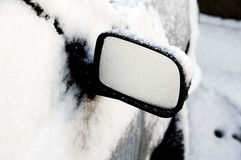 A Car front Wing mirror. In the snow Stock Photos