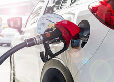 Car Fueling. Fueling in car at Gas station with Lens flare Royalty Free Stock Photography