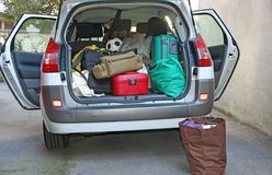 Car full of luggage before departure. Family holiday Stock Photos