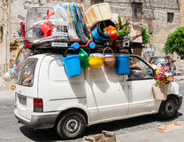 The car is fully loaded with luggage. Sicily Stock Image