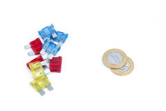 Car fuse. brazilian currency and pile of colorful electrical automotive fuses or circuit breakers Royalty Free Stock Photo