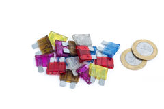Car fuse. brazilian currency and pile of colorful electrical automotive fuses or circuit breakers Stock Photo
