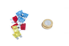 Car fuse. brazilian currency and pile of colorful electrical automotive fuses or circuit breakers Royalty Free Stock Images