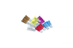 Car fuse. Pile of colorful electrical automotive fuses Stock Image