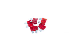 Car fuse. Pile of red electrical automotive fuses or circuit breakers isolated on white Stock Image