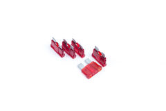 Car fuse. Pile of red electrical automotive fuses or circuit breakers Royalty Free Stock Photo