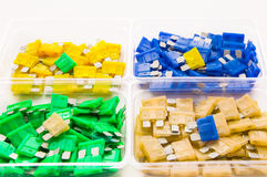 Car fuses. Colored car fuses laid out in boxes royalty free stock images