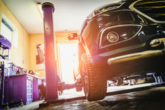 Car in garage. Of auto repair service shop with special repairing equipment Stock Photography