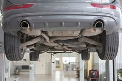 Car in garage, auto repair service shop with special repairing equipment stock photography