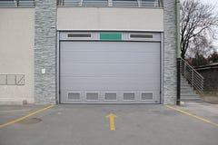 Car Garage. Closed Rrey Garage Door Entrance in Building Stock Image