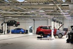 Car in garage. Car repairing in big and clean garage Stock Photo