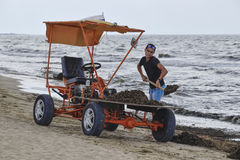 The car for garbage collection from the beach. Cleaning on the beach, clean beach from mud and waste Stock Photography