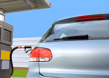 Car at gas station. At the gas station pump putting gas into the car Royalty Free Stock Photos