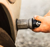 Car at gas station being filled with fuel Stock Image