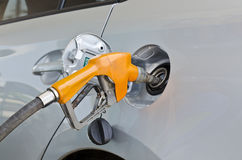 Car at gas station being filled with fuel Stock Photo