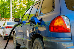 Car at gas station. The car is fueled with gasoline at the gas station royalty free stock images