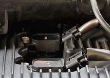Car gasoline engine servicing, ratchet and spark plug Royalty Free Stock Photos