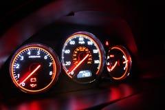 Car Gauges. Illuminated at night on a Honda Civic Stock Photography