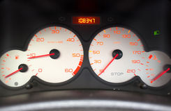 Car gauges. Gauges for speed, fuel tank, and other measurements on car panel Stock Photography