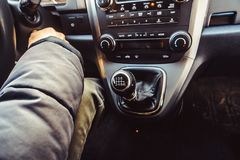Car gear box lever. Lever manual six-speed gearbox. Gear-lever view from above. Handle a manual transmission in a blurry background. Six speed manual gear stick stock photography