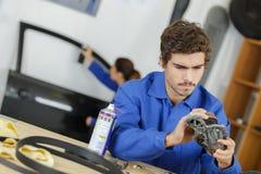 Car gear box repair automotive repair workshop garage mechanic. Mechanic royalty free stock photography
