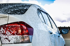 Car getting a wash with soap Stock Photography
