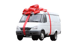 The car in a gift. The white van which has been tied up by a red gift tape Stock Photography