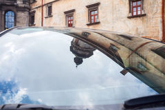 Car glass city mirror. Mirror of old historical city in the car glass Royalty Free Stock Photo
