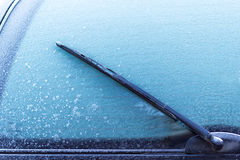 Car glass iced. Clean frozen glass Stock Images