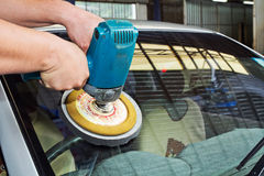 Car Glass polishing with power buffer machine. CAR CARE images. closeup Useful as background for design-works Royalty Free Stock Image