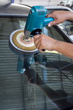Car Glass polishing with power buffer machine Stock Image