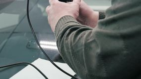 The car glass repair specialist fix auto glass. stock video footage