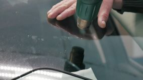 The car glass repair specialist fix auto glass. stock footage