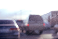 Car glass with unclean texture. Blurred road on background Stock Image