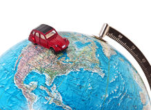 Car on a globe. A toy car on a globe - world travel concept Stock Photo
