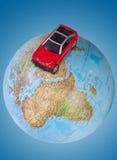Car on globe Stock Image