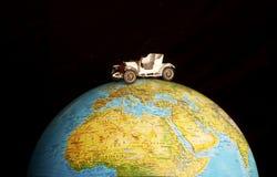 Car on globe Stock Photos