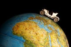 Car on globe Stock Photo