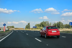 Car goes on country highway Stock Image
