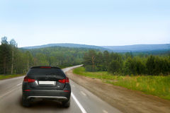 Car goes on country road Royalty Free Stock Photos