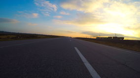 Car goes on highway and view of a passing train stock video footage