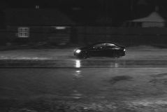 Car goes at night to rain on road Royalty Free Stock Photos