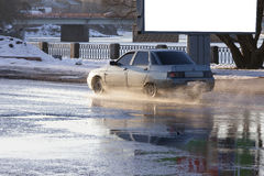 The car goes on a pool with splashes Stock Image