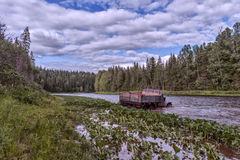The car goes through the river. Great Soviet car goes over a river in the Ural forests Royalty Free Stock Photos