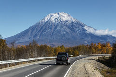 Car goes on the road to Koryaksky Volcano on Kamchatka. Russia Royalty Free Stock Image